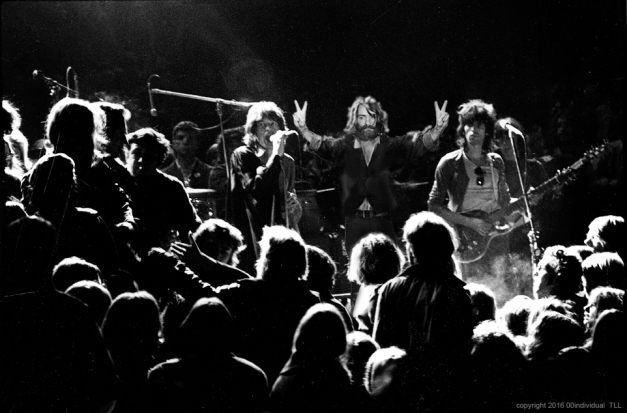 LIVERMORE, CA - DECEMBER 6: Mick Jagger and Keith Richards of the Rolling Stones warily eye the Hells Angels at The Altamont Speedway on December 6, 1969 in Livermore, California. (Photo by Robert Altman)